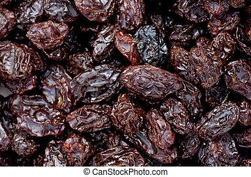 Raisins - Background texture of several raisins.