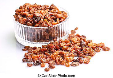 Raisins in a glass bowl over white