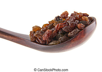 Raisins in a wooden spoon isolated on white background