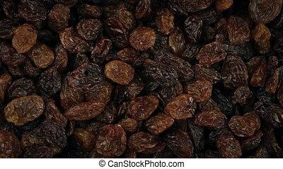 Raisins Rotating Closeup - Overhead macro shot of raisins
