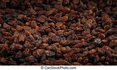 Raisins Snack Rotating Closeup - Closeup of pile of raisins...
