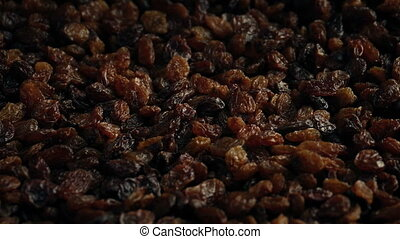 Raisins Turning Slowly - Macro shot of pile of raisins...