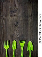 rake, trowel for gardening on wooden background top view mock up