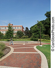 RALEIGH,NC/USA - 8-10-2020: Student wearing a facemask walks on campus at NC State University in Raleigh, NC after returning to classes for Fall semester during the Coronavirus pandemic