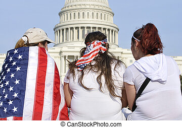 Washington D.C. - April 10, 2013: Demonstrators show their American patriotism by wearing the nation's flag in front of the capitol during a demonstration for immigration reform on April 10, 2013.