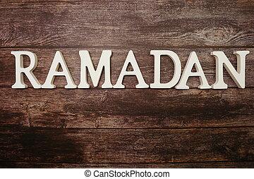 Ramadan alphabet letters on wooden background