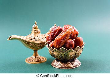 Ramadan, Dates in golden bowl, arabian Aladdin golden lamp vintage style