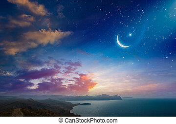 Ramadan Kareem background, rising crescent and stars above dark mountains and serene sea. Elements of this image furnished by NASA