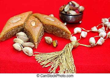 Ramadan scene-sweets , nuts and prayer beads