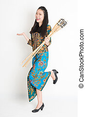 Ramadhan - Full body portrait of happy Southeast Asian woman...