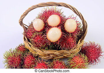 Rambutan in basket on white background