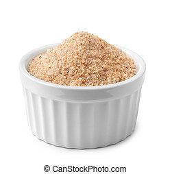 Ramekin with bread crumbs isolated on white