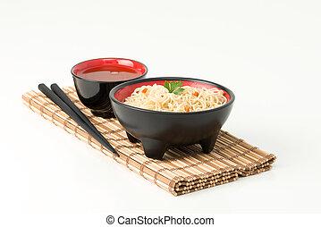Ramen Noodle Bowl - Bowl of Japanese ramen noodles and a cup...