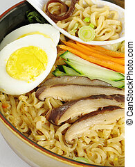 Ramen With Egg - A bowl of ramen soup topped with a hard...