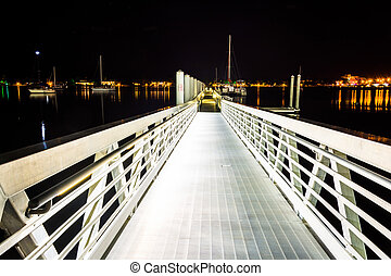 Ramp to a dock at night in West Palm Beach, Florida.