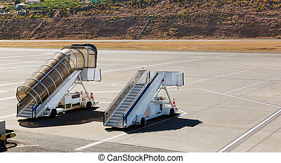Two ramps standing on the airfield