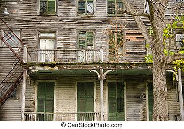 Big old decrepit house, with shuttered windows