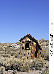 Ramshackle Outhouse - A dilapidated outhouse on the verge of...