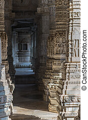 Ranakpur, India - February 2, 2017: Interior of the majestic jainist temple at Ranakpur, Rajasthan, India. Architectural details of stone carvings, wide angle view.