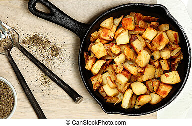 Ranch Potatoes in Cast Iron Skillet on Cutting Board with ...