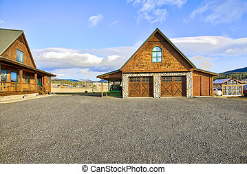 Ranch style home with detached garage in the countryside.