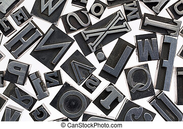 random letters in metal type