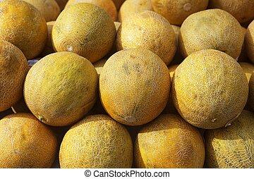 rangées, empilé, jaune, fruits, melon, marché