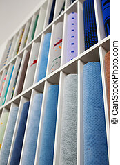 Range of coloured carpets in a store - Low angle view of a...