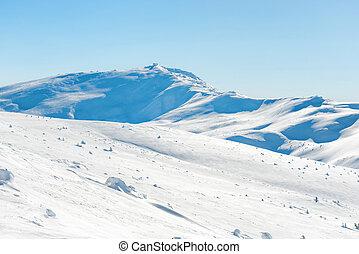 Range of mountains peaks in snow