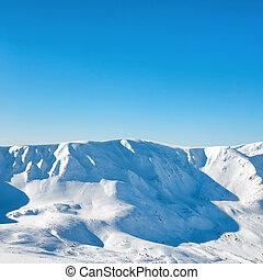 Range of white winter mountains peaks