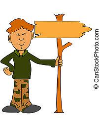 Ranger boy holding a sign