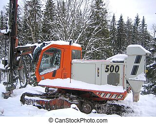 Ranger drill rig in forest with snow