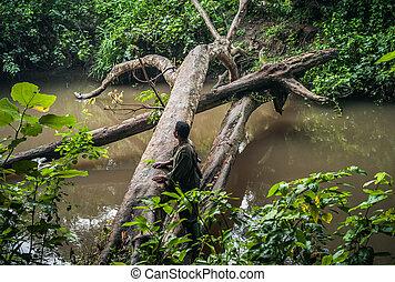 Queen Elisabeth National Park, Uganda - July 23 2011: Ranger Looking for Wildlife in the Jungle