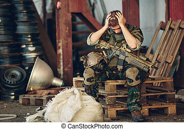 ranger sitting with arms and hands holding her head