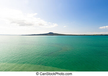 Rangitoto Island view from Mission Bay in Auckland, New Zealand.