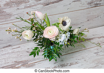 Ranunculus and the anemones in vase. - Bouquet of ranunculus...