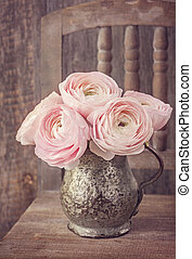 Ranunculus flowers in a old vase