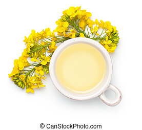 Rapeseed oil with rape flowers isolated on white background. Top view