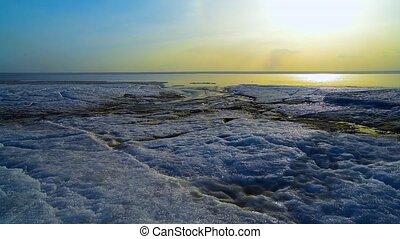 Rapid flow of melt water. Siberia, spring, Novosibirsk...
