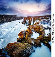 Rapid flow of water powerful Selfoss cascade. Popular...