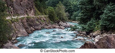 Rapid mountain river and cliff