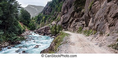 Rapid mountain river and red cliff