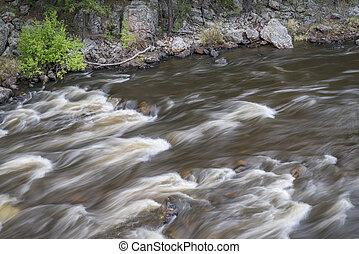 rapid on the Cache la Poudre River in Big Narrows, Colorado