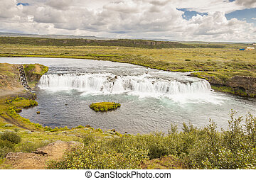 Rapid river and small cascade - Iceland.