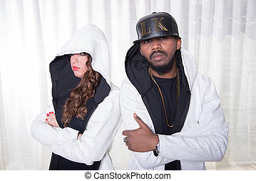 Rapper style couple is posing