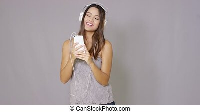 Rapturous young woman listening to music