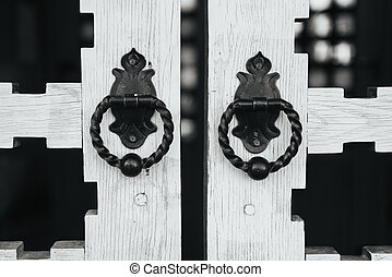 Rare door knobs on wooden gates