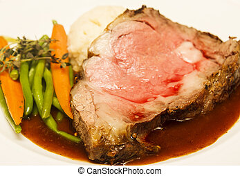 Rare Prime Rib with Vegetables - Rare slab of prime rib beef...