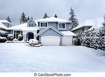 Rare snow storm in Northwest United States with residential home in background