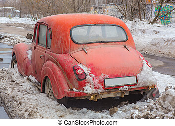 rare vintage car is parked in the winter